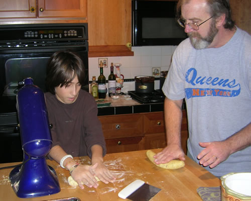 Tim and Gino rolling out biscotti